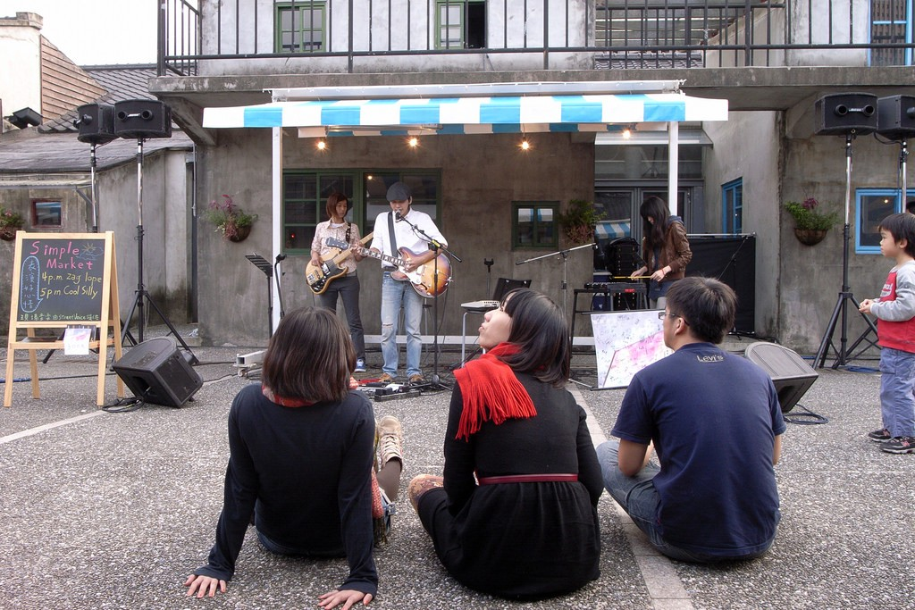 Teenagers enjoying buskers' music at 44 South Village